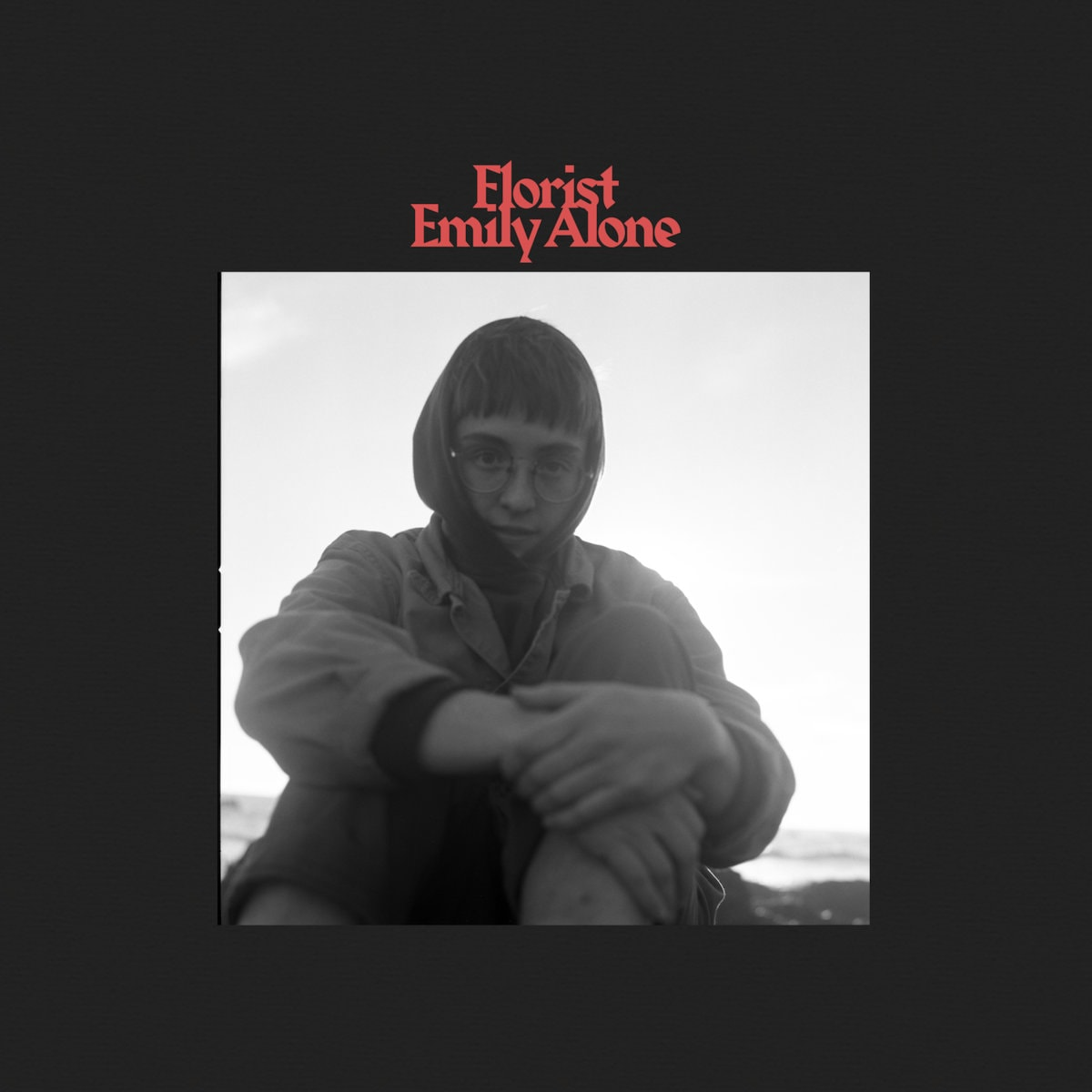 Album cover of Emily Alone by Florist. Black & white photo of Emily Sprague inside thick black border with red text above.