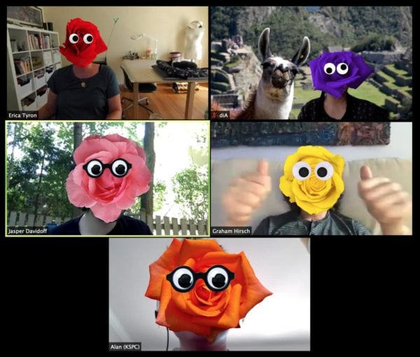 A Zoom Call With Five People Whose Heads Are Multicolored Roses With Googly Eyes